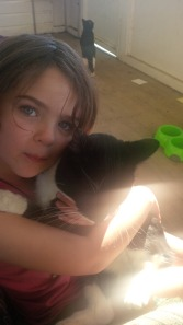 Miss 5 and her cat Blacky.